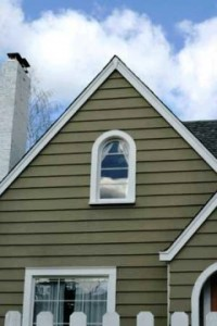 An image showing a new vinyl siding job on a house.